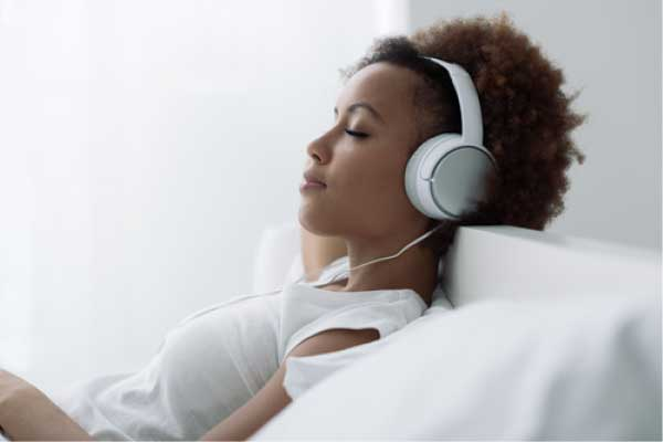 Woman with headphones on, relaxing