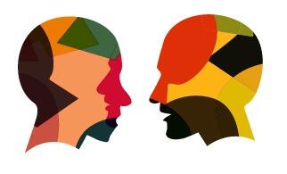 Multicolor silhouettes of heads facing each other