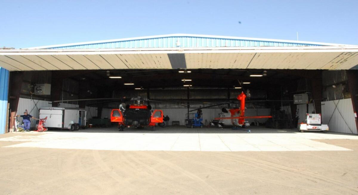 MH-60 helicopters in their leased hangar in Barrow