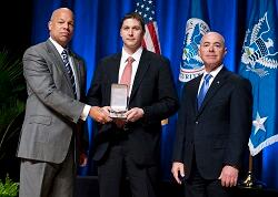 On October 23, 2014 Secretary Jeh Johnson and Deputy Secretary Alejandro Mayorkas awarded the Secretary's Exceptional Service Award to Tate Jarrow, U.S. Secret Service for work on the Liberty Reserve Investigation, which exposed a website used to facilitate cybercriminal activity, including investment and foreign exchange schemes, child exploitation, drug trafficking and terrorism, and resulted in the dismantling of the website and the freezing of $40 million in assets, affecting cybercriminal activity worldwide.