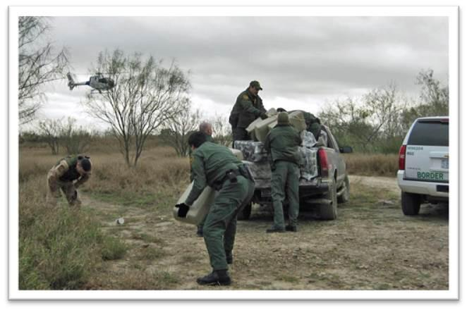 Four Custom and Border Protection Agents patrolling the south Texas Border in vehicles with a helicopter flying overhead