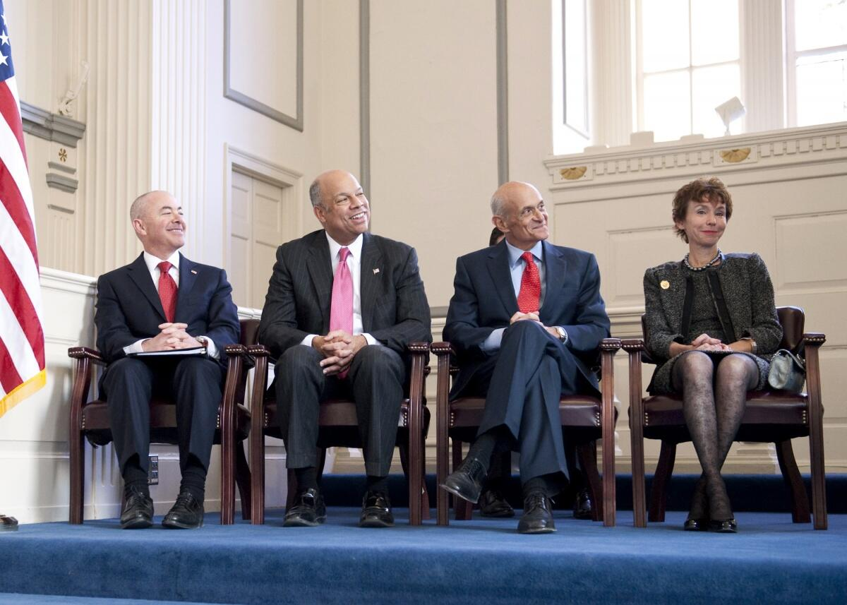 Deputy Secretary Mayorkas, Secretary Johnson, Former Secretary Chertoff, and Mrs. Chertoff during the Official Portrait Unveiling Ceremony. Official DHS photo.