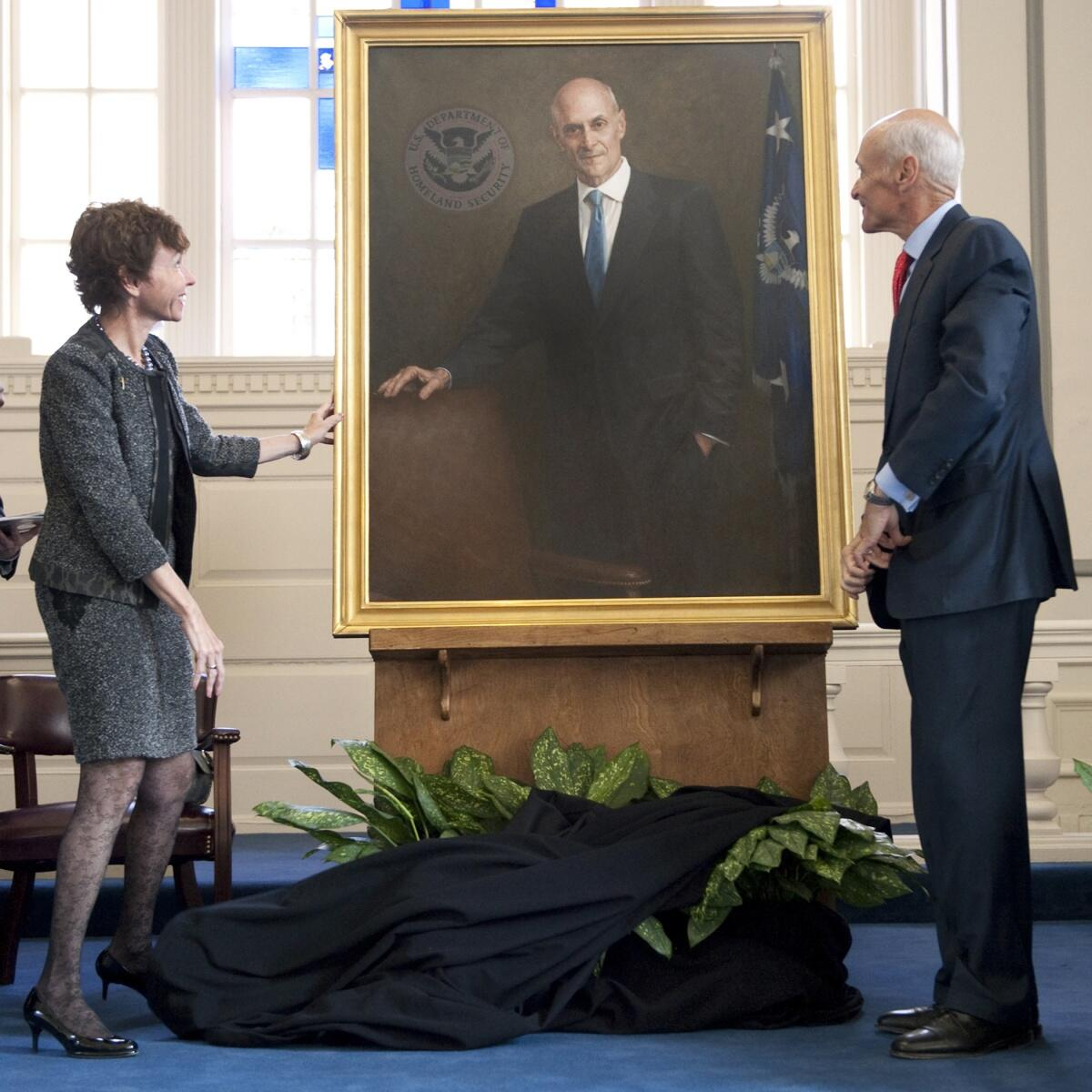 Secretary Chertoff and his wife, Mrs. Meryl Chertoff, unveil his official portrait. Official DHS photo.