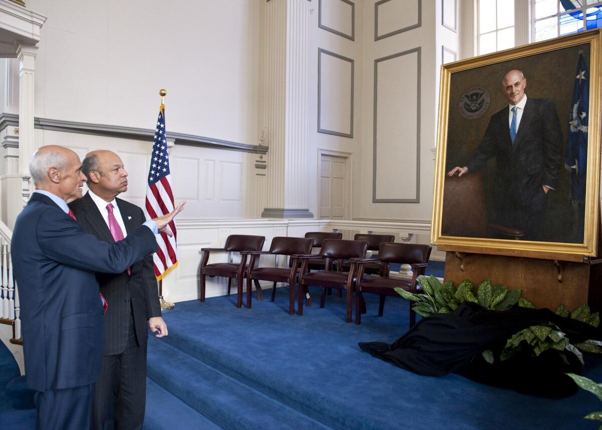 Secretary Johnson and Former Secretary Chertoff talk after the portrait unveiling. Official DHS photo.