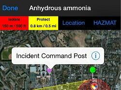 "First App Screen Capture, Resized. Image reads: Done (button) with Anhydrous ammonia (title). Undeath a row of coordinates and data points state: Isolate 150 m / 500 ft; Protect 0.8 km / 0.5 mi; Location (button) and Hazmat (button). A statelight map of the area with a red pin labels the area with ""Incident Command Post""."
