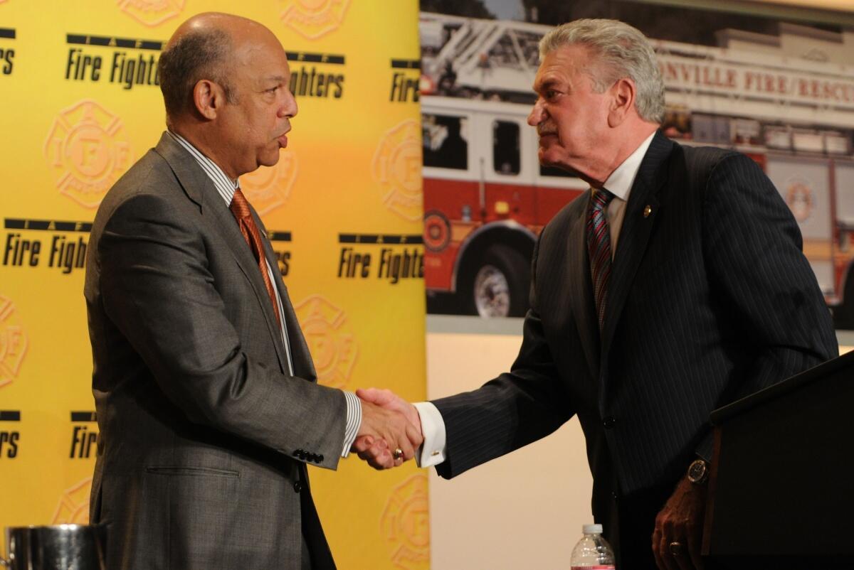 Secretary Johnson and IAFF President Shaitberger shake hands.
