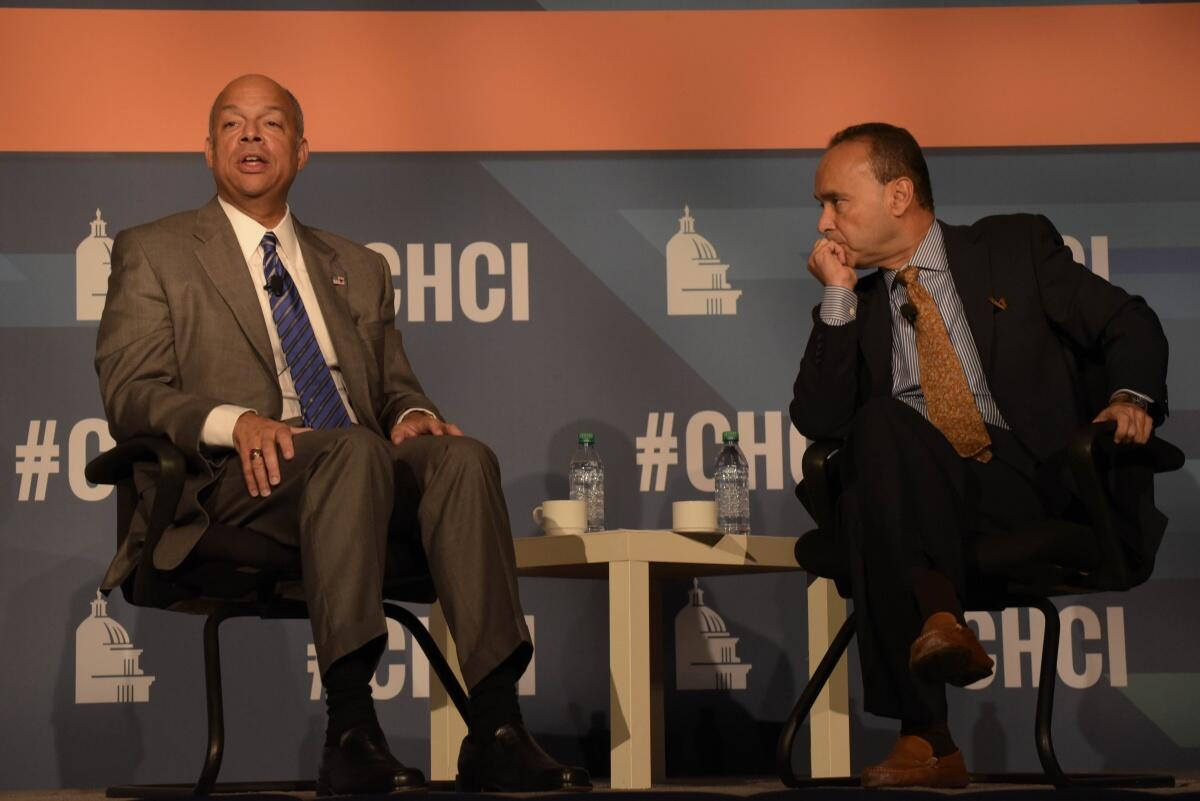 Representative Luis Gutiérrez and Secretary Johnson confer before the Secretary's remarks at the Congressional Hispanic Caucus Institute 2015 Public Policy Conference.