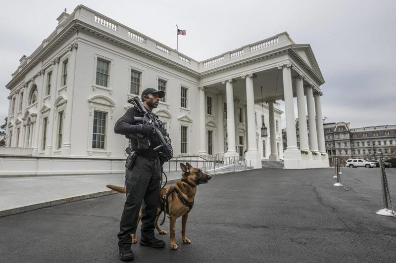 Secret Service officer in front of the White House