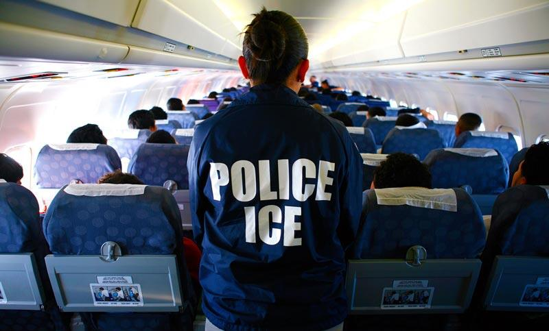 ICE officer on a repatriation flight