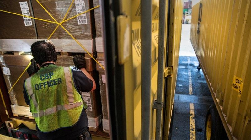 CBP officer inspects shipping containers