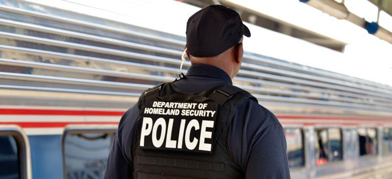 DHS officer patrols a train platform