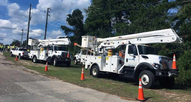 Utility trucks staged for response