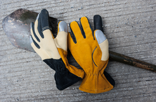 Flex-Tuff HS (formerly Improved Structure Firefighting Glove) laying on a shovel
