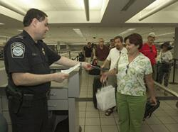 Passenger screening by CBP Officer.