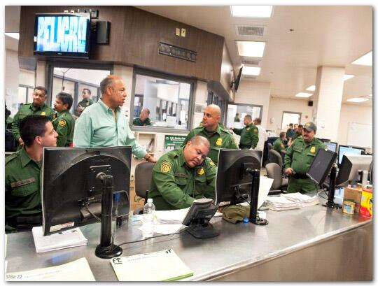 Slide 22: Secretary Jeh Johnson visiting with Customs and Border Protection officers at a CBP station