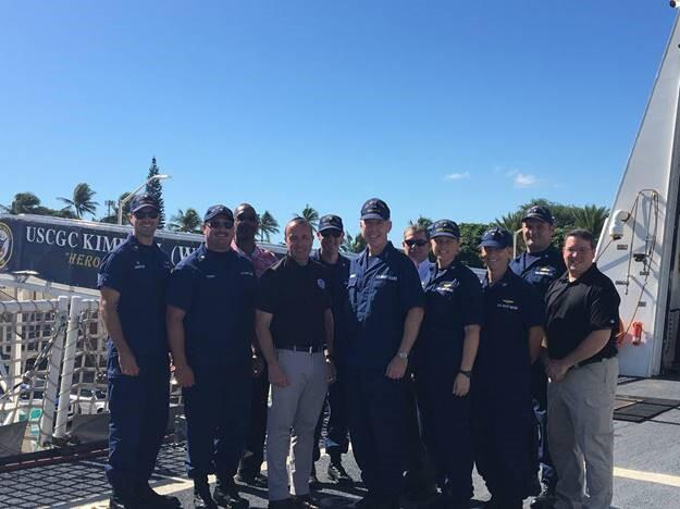Under Secretary David J. Glawe with the United States Coast Guard and I&A Chief of Staff, Matthew Hanna (far left)