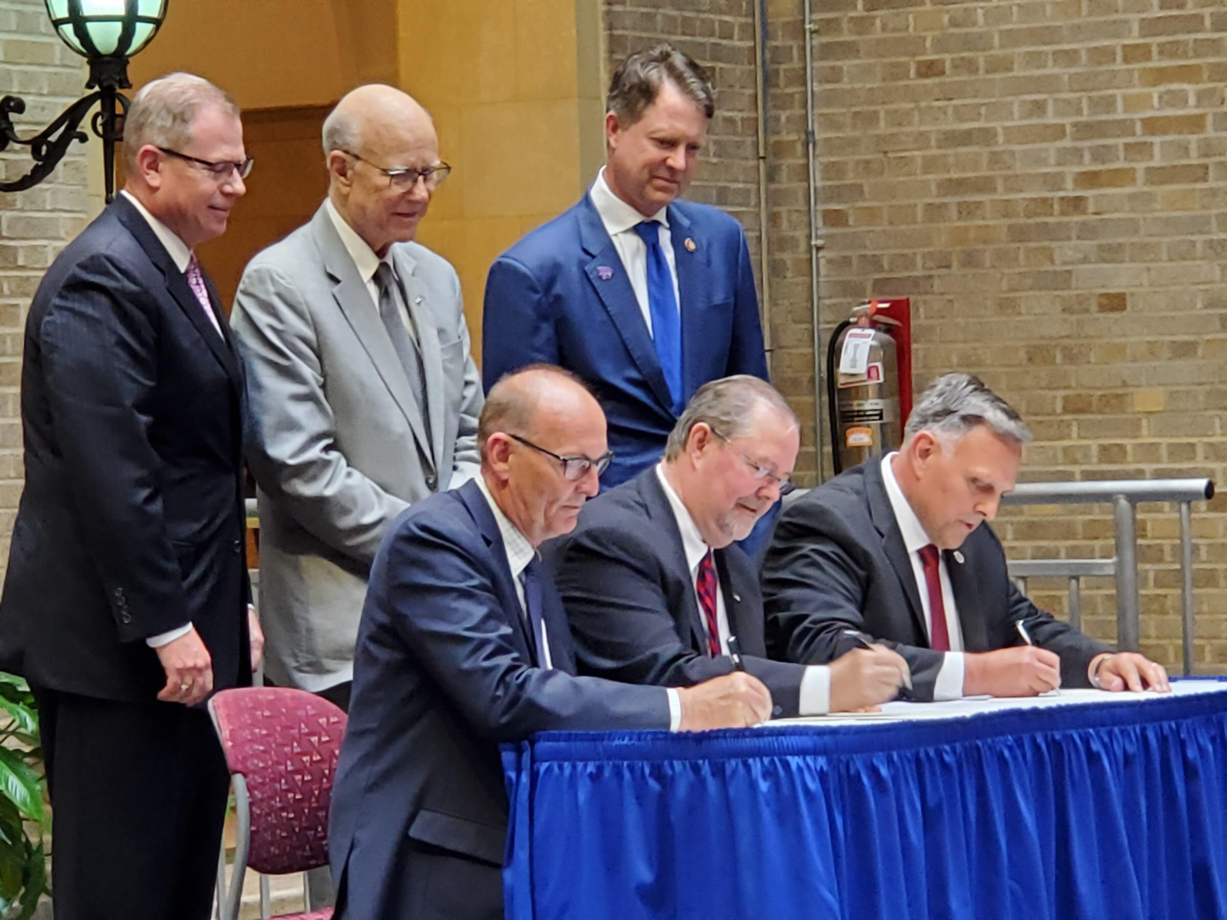 The agreement was signed by USDA Under Secretary for Marketing and Regulatory Programs Greg Ibach, USDA Deputy Under  Secretary for Research, Education, and Economics Scott Hutchins, and DHS Senior Official Performing the Duties of the Under Secretary for Science and Technology William Bryan