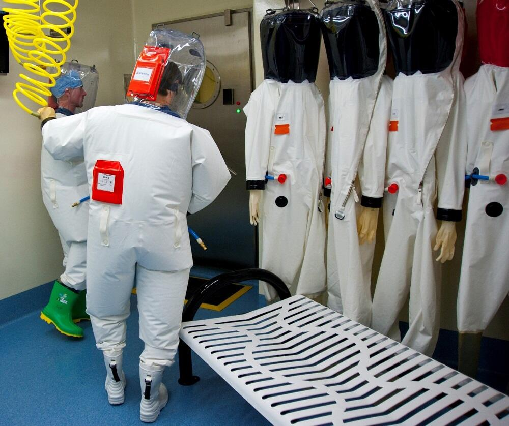 The biocontainment suit ensemble is designed to provide maximum protection to National Biodefense Analysis and Countermeasures Center / NBACC personnel. When workers exit the biocontainment laboratory, the suit is decontaminated with a thorough chemical showering process that inactivates any contaminating materials.