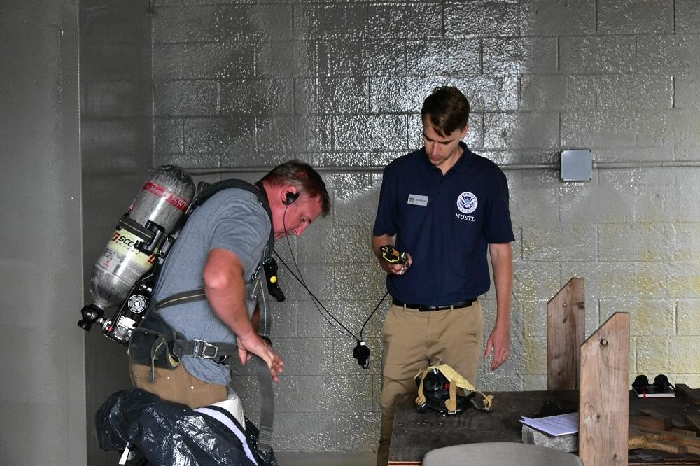 National Urban Security Technology Laboratory / NUSTL staff help evaluate technology and collect data for an in-suit communications SAVER assessment.