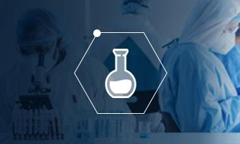 Icon of an lab flask in a honeycomb shape over a blue screened photo of people working in a lab.