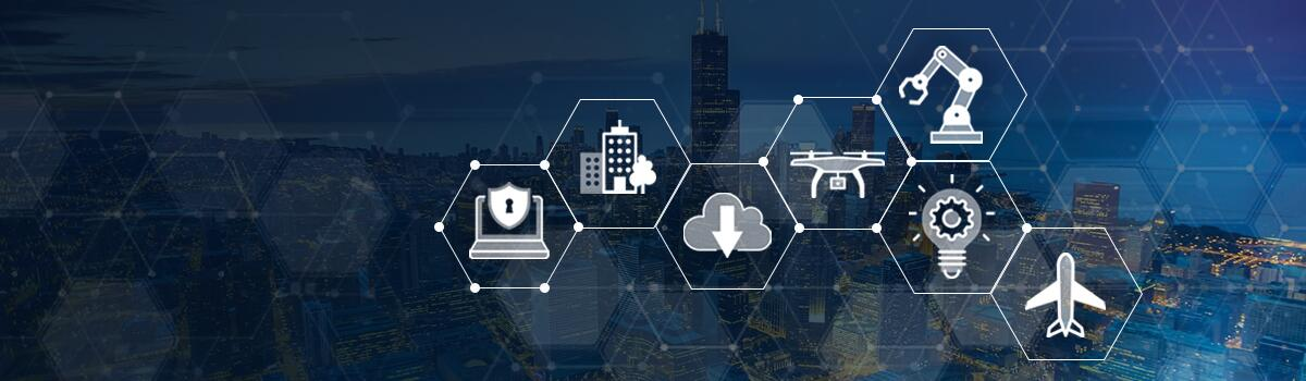 Pattern of icons in honeycomb shapes over a photo of a city at night. Icons are computer and shield with a key hole; apartment  building; cloud with a downward pointing arrow; drone; mechanical arm; light bulb; and airplane