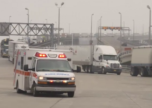 An ambulance crosses the Blue Water Bridge during scenario 1 of the CAUSE IV experiment.