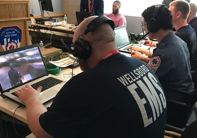 Actual first responders at laptops navigating an EDGE scenario at a recent training event in New York City