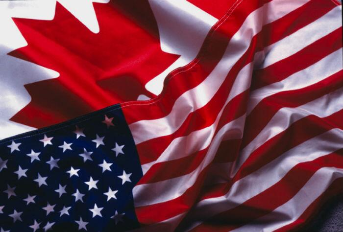 Part of the Canadian flag and the U.S. flag.