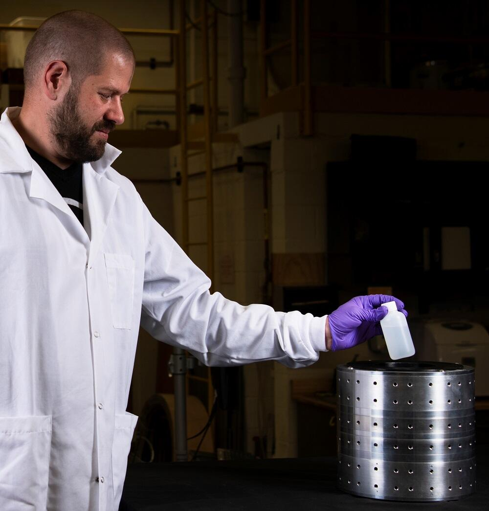 A LANL scientist uses SEDONA to scan the contents of a bottle for the presence of dangerous chemical weapons.
