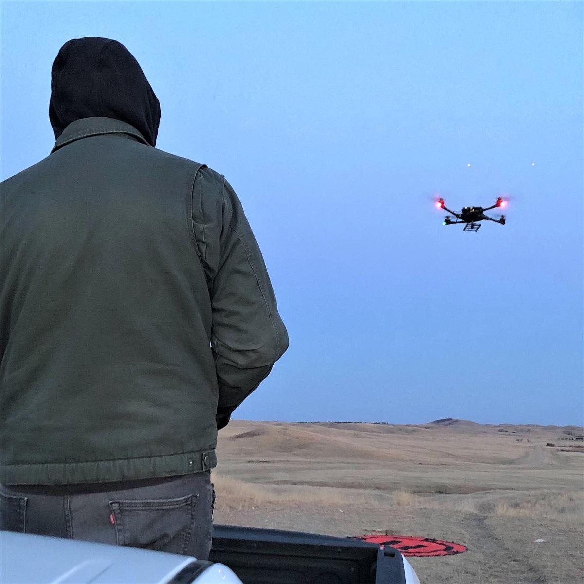 An Unmanned Aircraft System pilot simulates an evening surveillance flight with an Alta X drone.