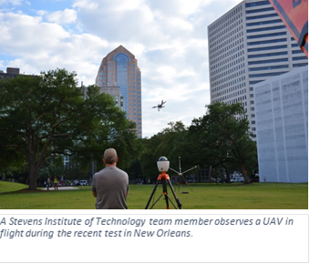A Stevens Institute of Technology team member observes a UAV in flight during the recent test in New Orleans
