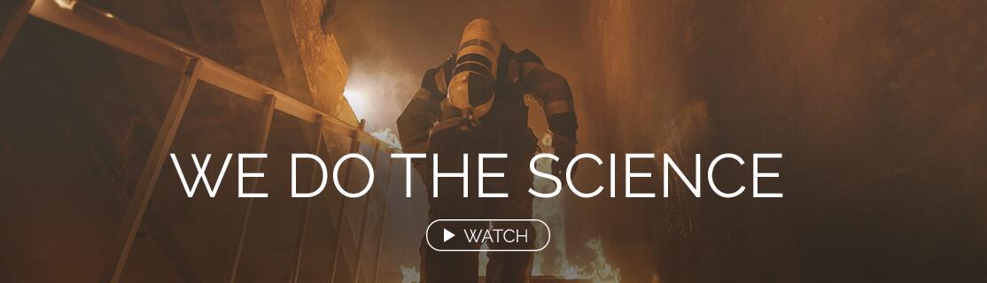 We Do the Science. Watch. Fireman running up stairs in a house in flames.