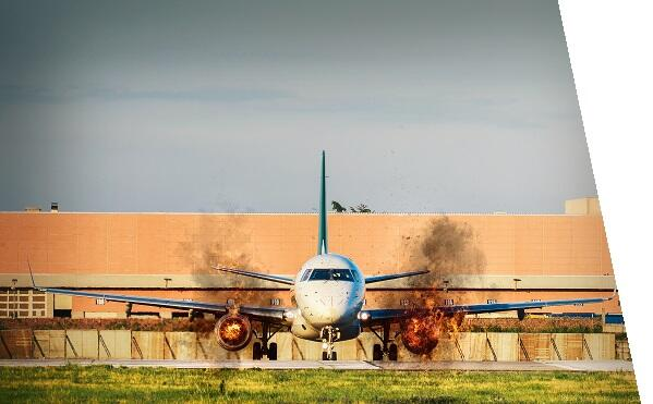 An airplane with the engines on fire