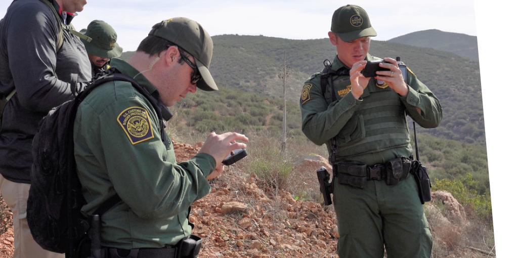 Border agents using hand held devices.