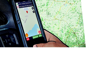A hand holding a smartphone with a map on the screen