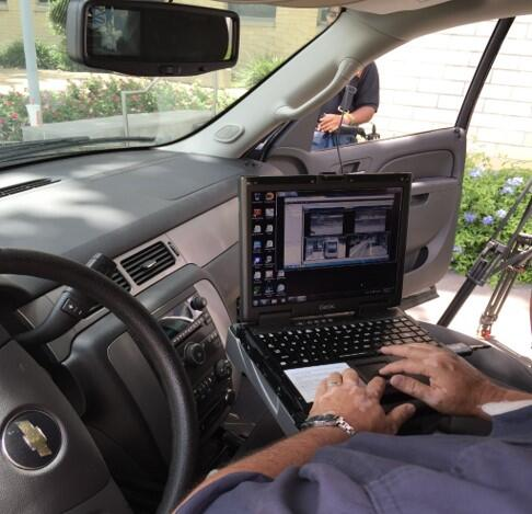 A police officer using his car computer.