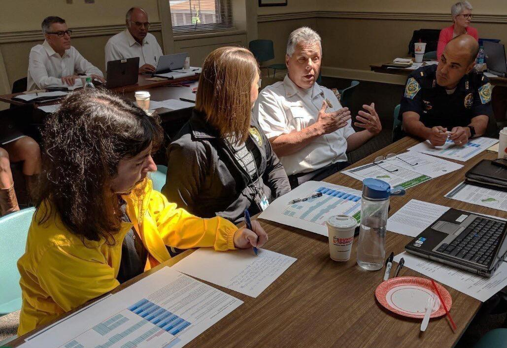 Nashua, N.H., community members discuss the scoring and geographic placement of a policy as part of a Plan Integration for Resilience Scorecard (PIRS) activity.