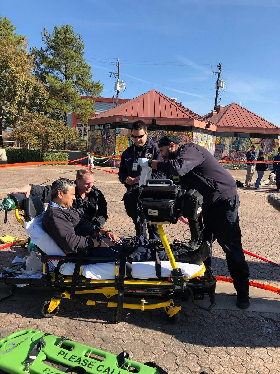EMT responders treated a simulated victim; vital sign information from multiple simulated patients being transmitted was transmitted wirelessly to EMTs conducting  triage.