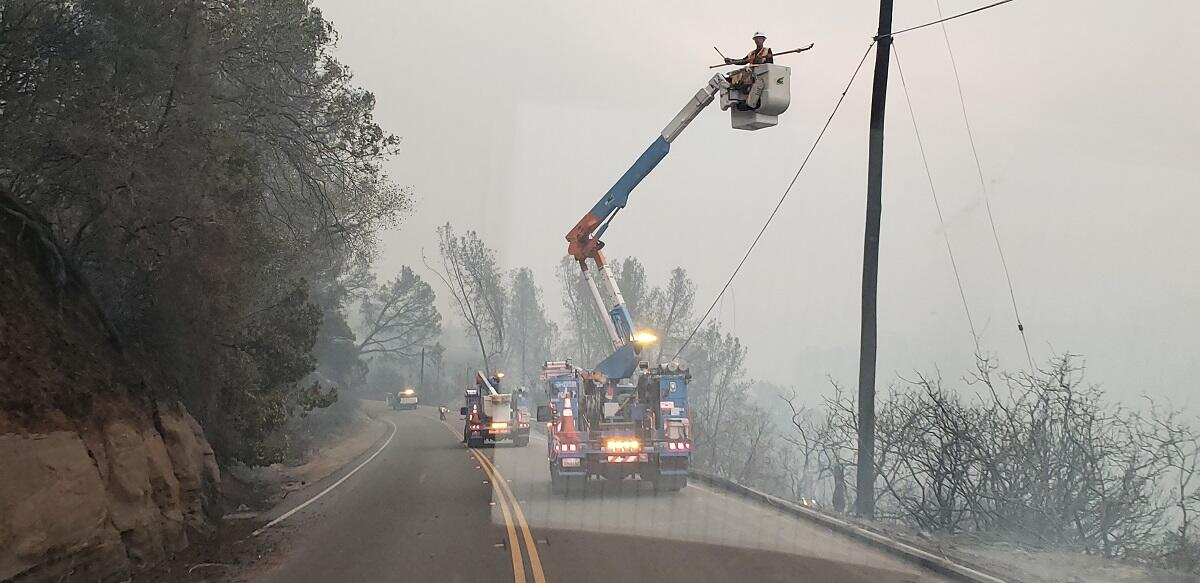 Utility workers secure power lines during 2018 wildfires in Paradise California. Photo courtesy of Roseville Fire Department, California