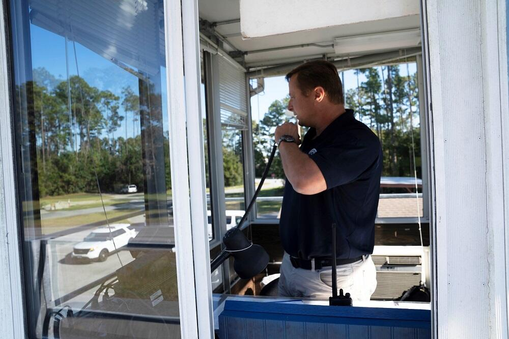 A FLETC instructor dispatches students to mock scenarios during driver training.