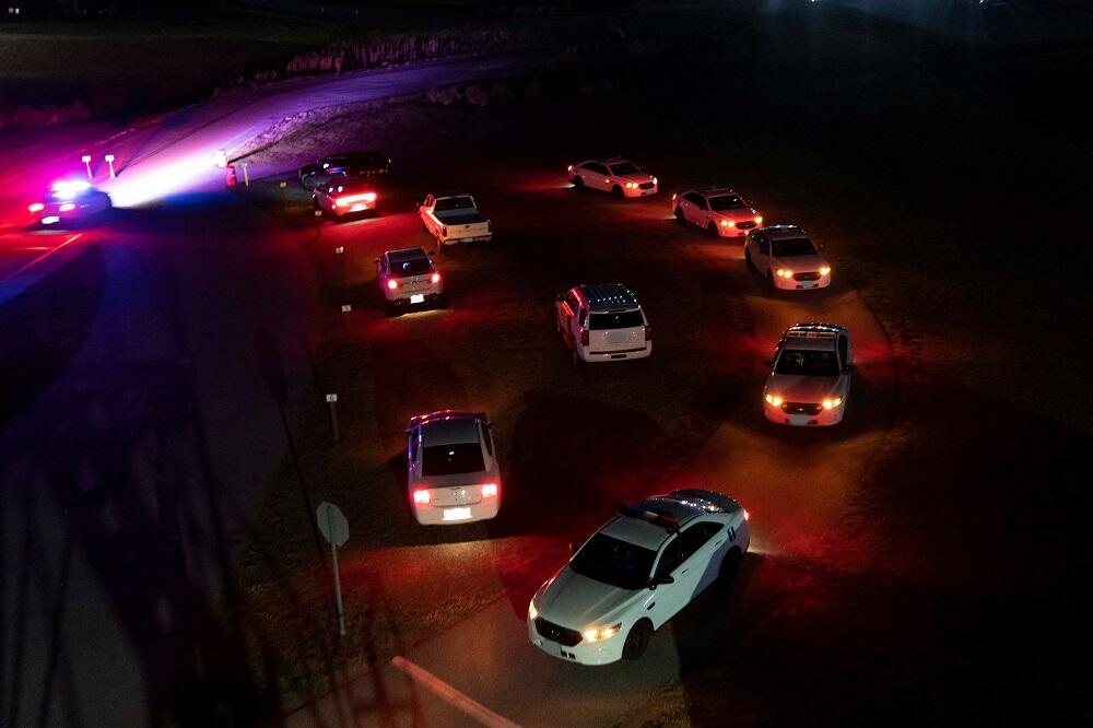 Students prepare to run night time driving drills on FLETC's various ranges