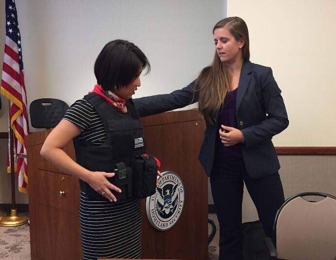 NUSTL Director Alice Hong (left) samples one of the body armor models at the focus group.