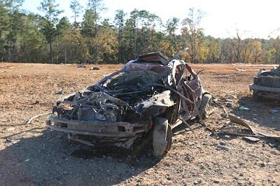 Phtest vehicle shows post-detonation damageoto left, test vehicle shows post-detonation damage.