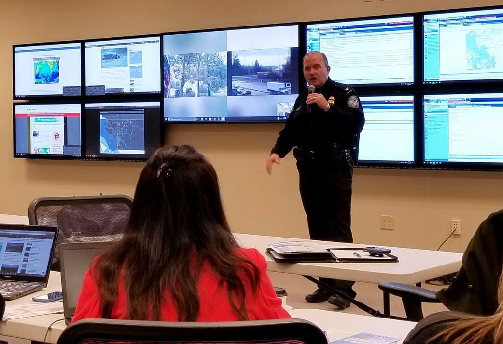 CBP official is briefing the Whatcom County emergency operation center on the daily activities of CBP officers participating in CAUSE V.