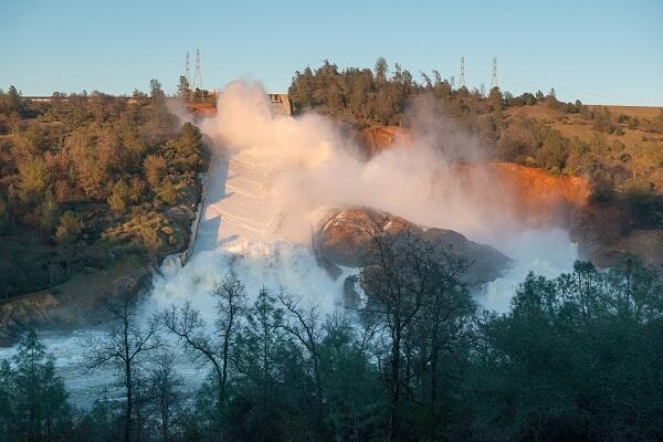 Water flowing from the eroded overflow spillway of Oroville Dam, CA. February 11, 2017