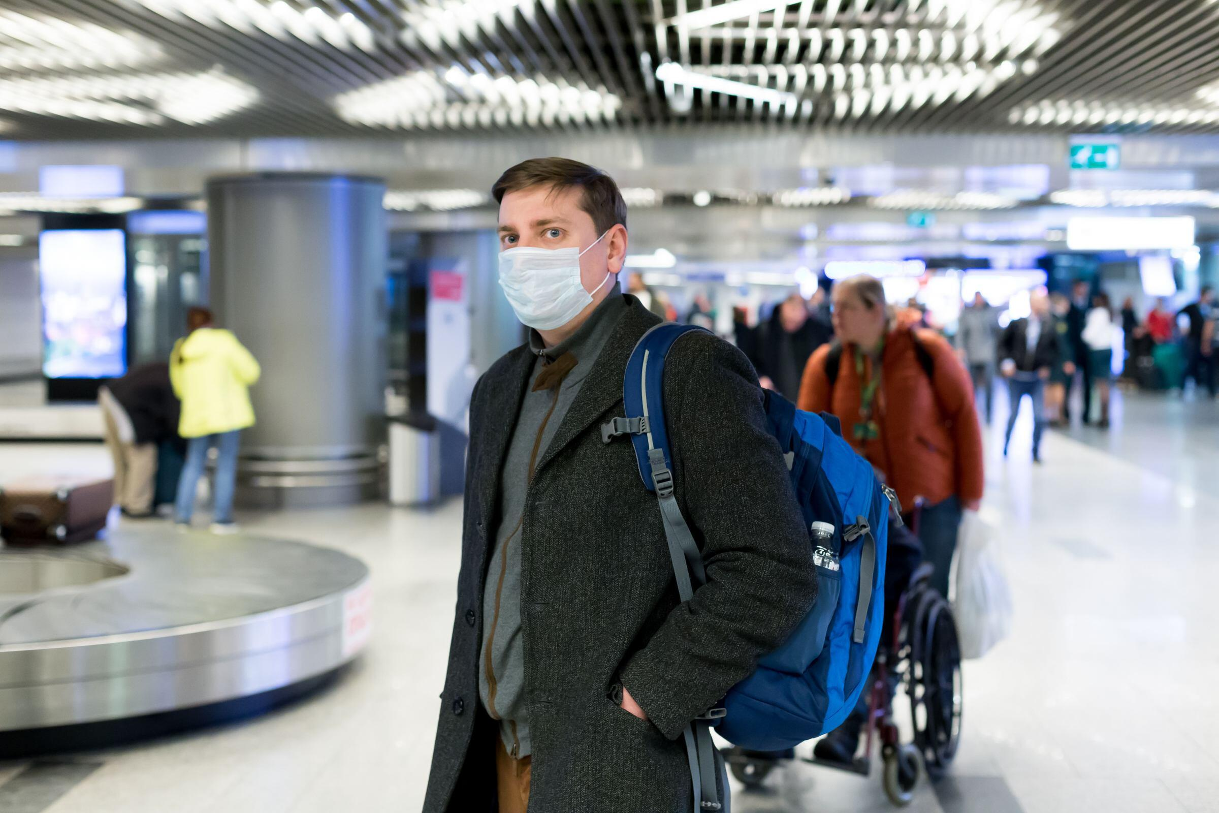 man in mask at airport