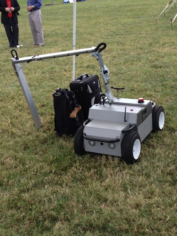 X-ray Scanning Rover demonstrates capabilities by scanning a suitcase.
