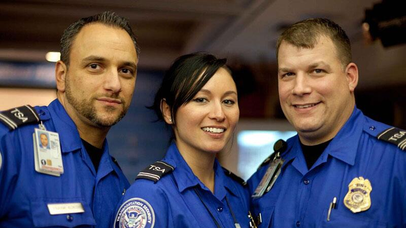 TSA employees smiling