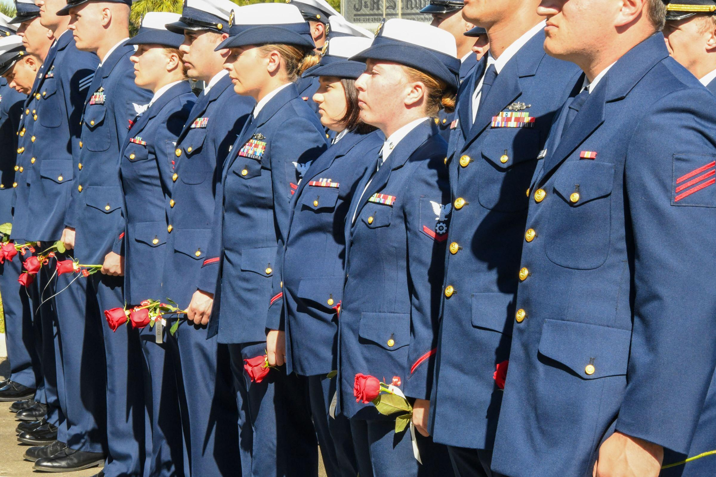 Members of the Coast Guard With Roses
