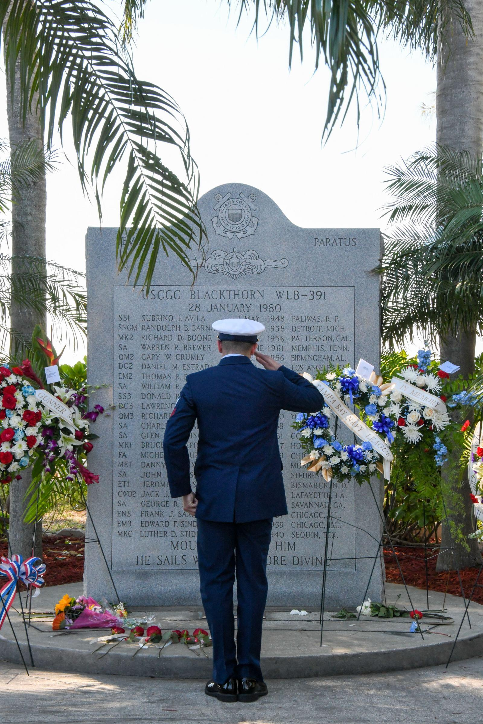 Coast Guard Member In Front of Monument
